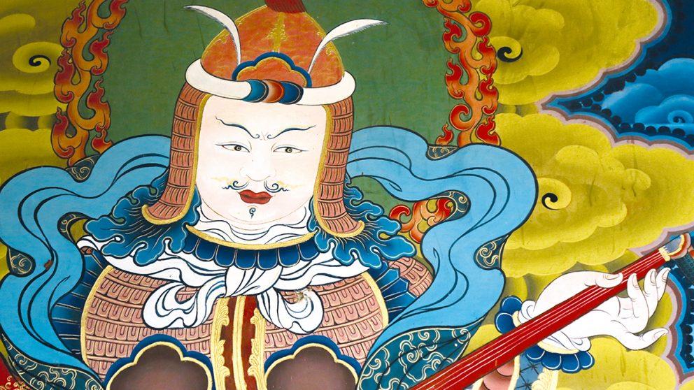 L'une des fresques qui adornent le Punakha Dzong au Bhoutan. Ces peintures dominées par des tons bleu et or accueillent le visiteur à l'entrée du fort.