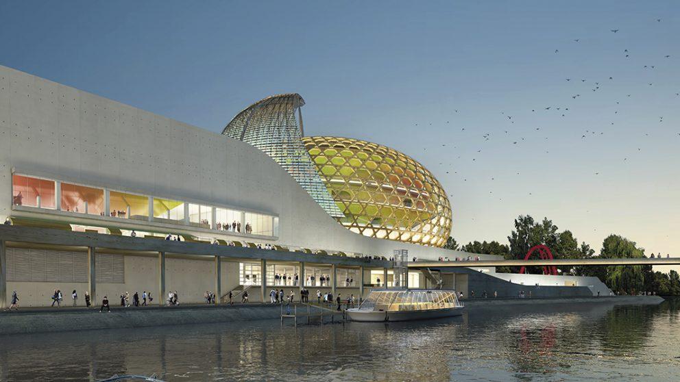 Cité musicale de l'île Seguin à Boulogne-Billancourt en France, ouverture prévue en 2016. Vue depuis la Seine, la Cité musicale offre des promenades le long du fleuve. Le dôme en bois recouvre la salle de musique classique.